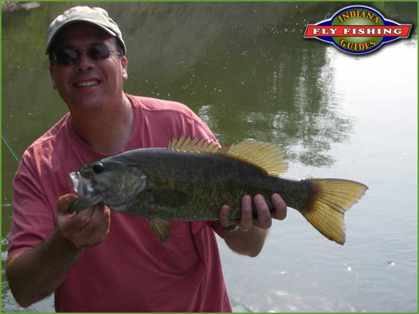 Todd Settle with a nice smallmouth on Sugar Creek