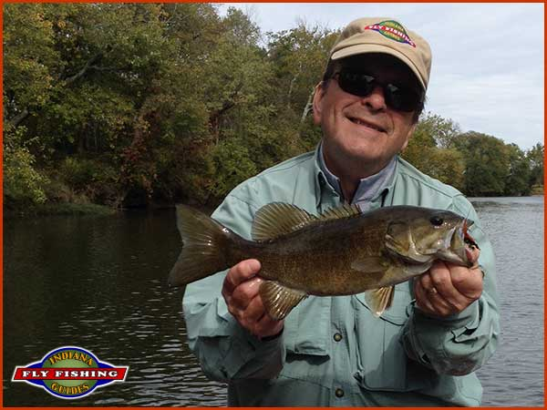 Eric Simpson with a nice smallmouth bass caught flyfishing on Indiana's White River