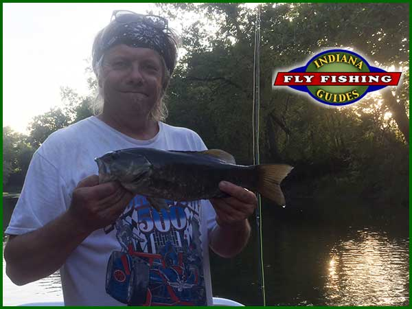 Dr. Steve Mangas fly fishing the White River in Indiana